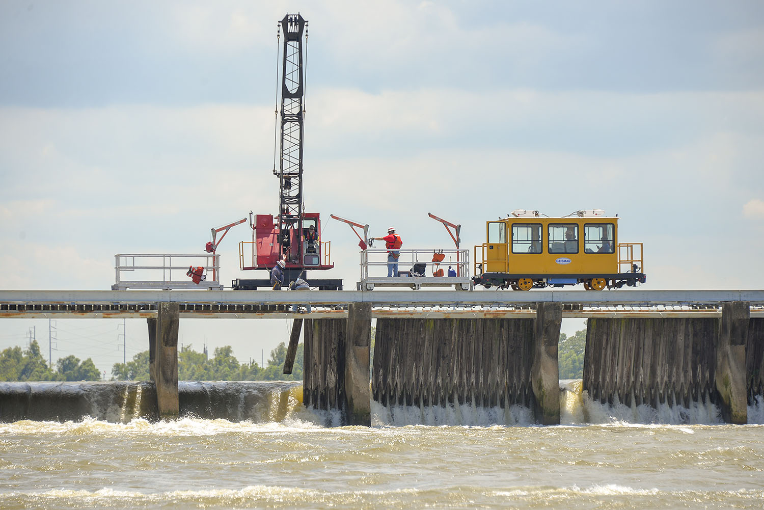 A Corps of Engineers crew works to close bays in the Bonnet Carré Spillway July 25. (Photo courtesy of New Orleans Engineer District)