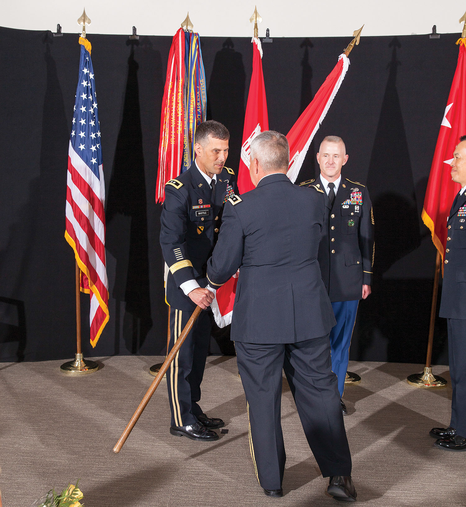 Maj. Gen. Robert Whittle Jr. accepts the Great Lakes and Ohio River Engineer Division flag from Chief of Engineers Lt. Gen. Todd Semonite during the division's change-of-command ceremony July 12 in Cincinnati, Ohio. (Corps of Engineers photo by Jack Sweenney)