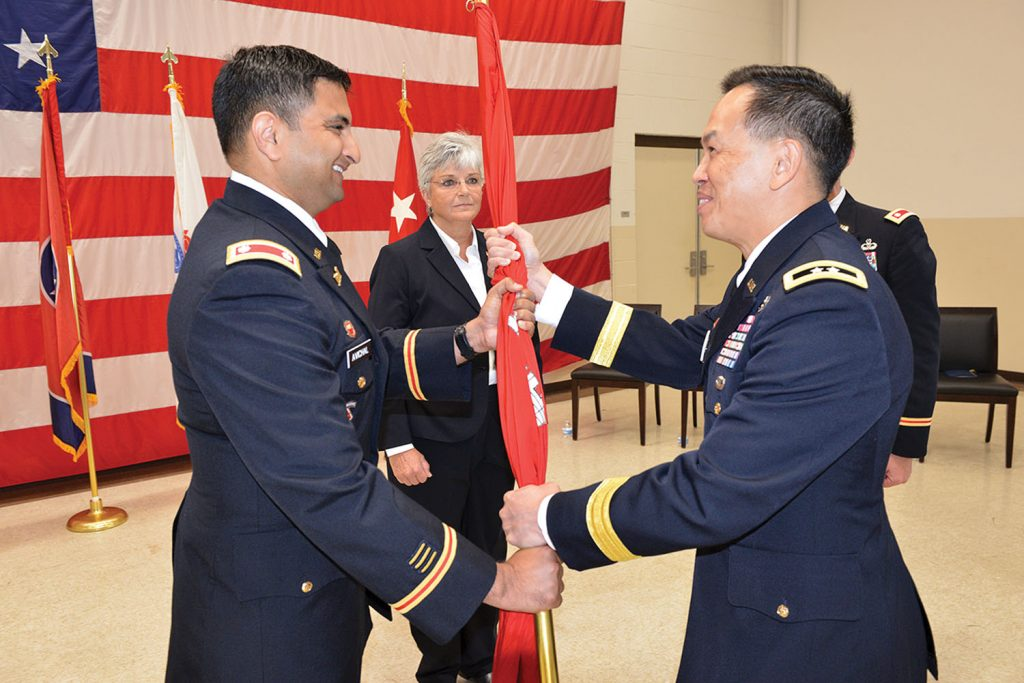 Maj. Gen. Mark Toy (Right), Great Lakes and Ohio River Engineer Division commander, passes the Corps of Engineers flag to Lt. Col. Sonny B. Avichal as Avichal took command of the Nashville District during a change of command ceremony June 28 at the Tennessee National Guard Armory in Nashville, Tenn.( Corps photo by Mark Rankin)