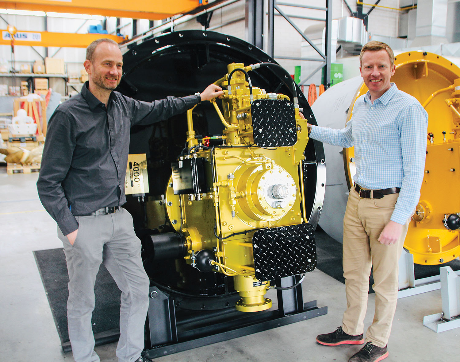 Erik Veth (left) and Tim Batten traveled to Greece to deliver a special-edition, golden thruster, the 4,000th thruster produced by Veth Propulsion since the first was built in 1986.
