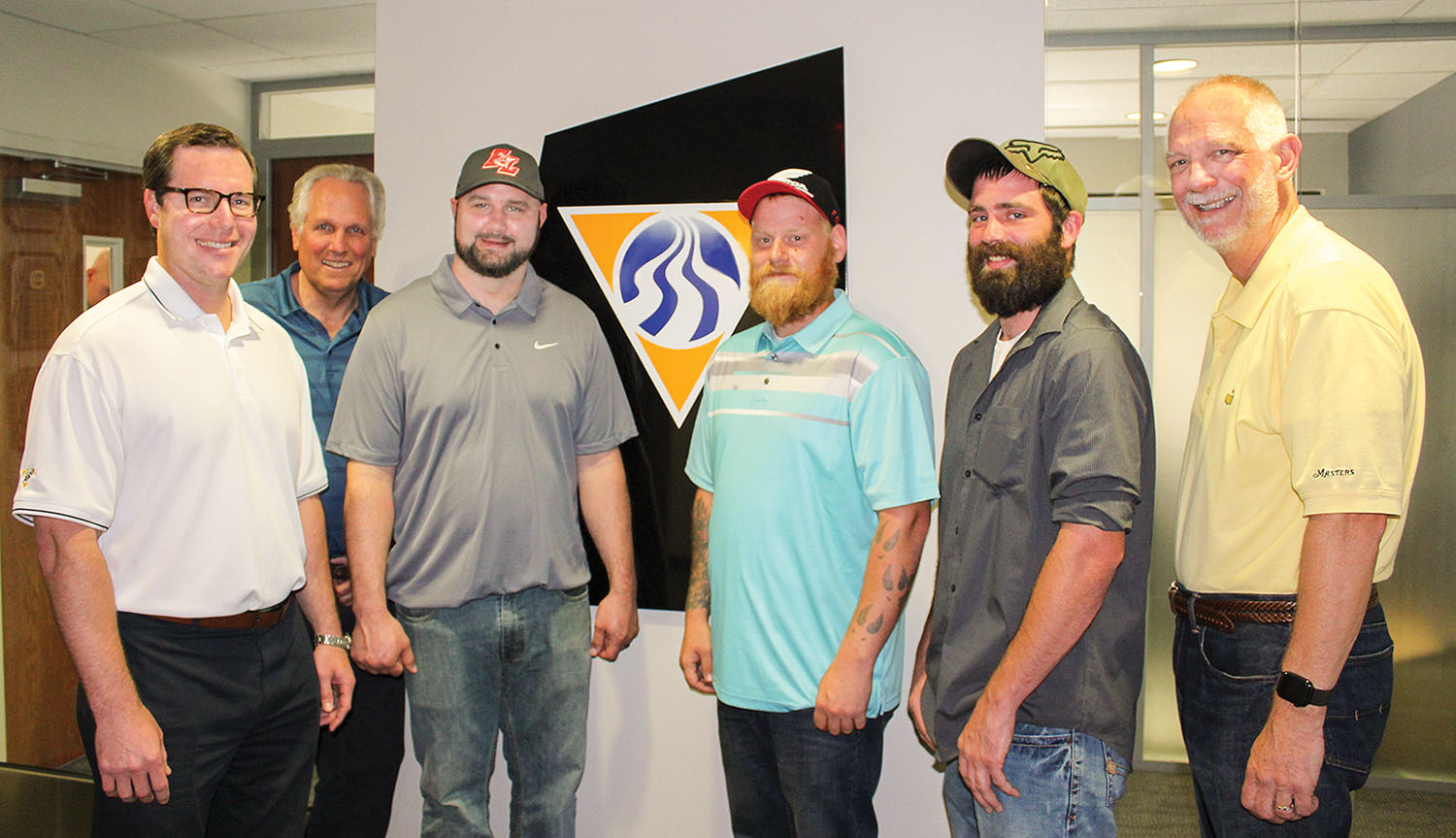 From left: Kyle Buese, executive vice president of operations; Peter Stephaich, CEO and chairman of the board; Capt. James Blake Jr.; Travis Neely, deckhand; Jared Starkey, deckhand; and Mike Monahan, president.