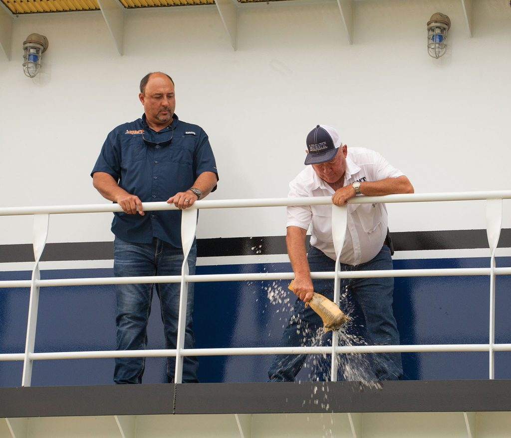 Everard Dupre christens namesake vessel while Rory Dupre looks on. (Photo by Frank McCormack)