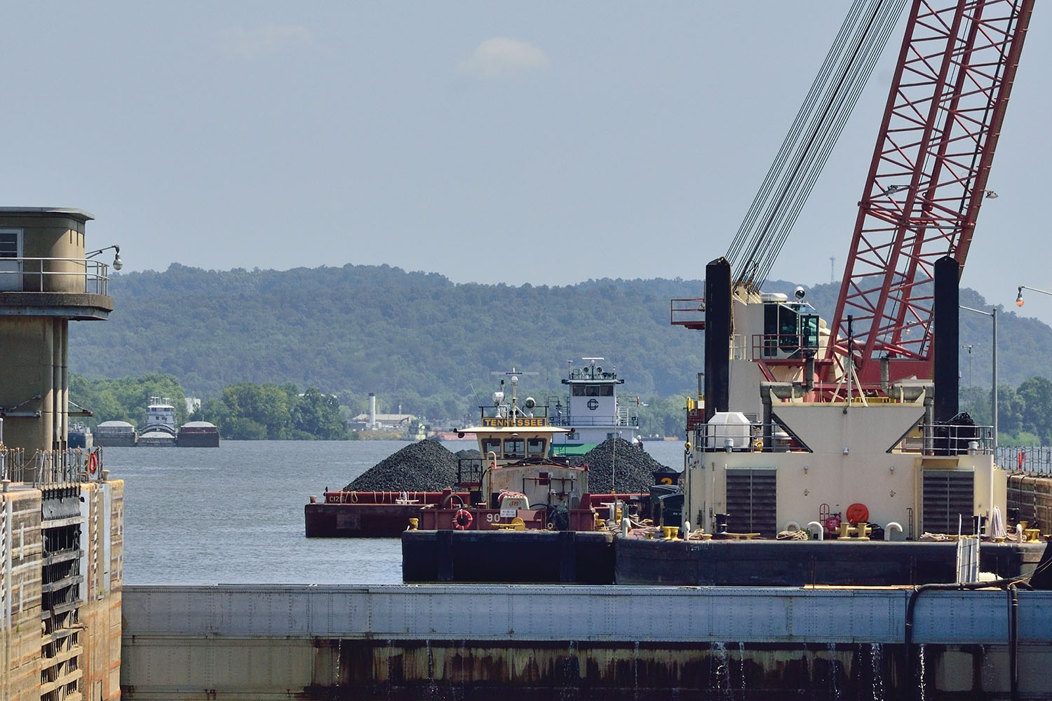 A Crounse Corporation boat has tied off its tow at the upper approach of the Willow Island Locks and Dam as it prepares to assist upbound boats through the auxiliary chamber during repairs to the main lock. (Photo by Jim Ross)