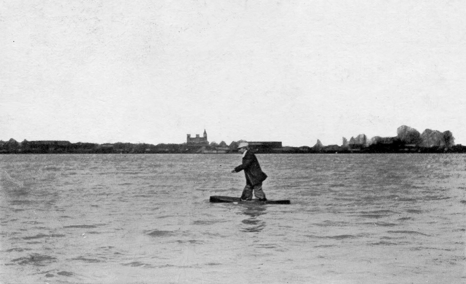 Charles Oldrieve walking on the Mississippi River at Arkansas City, Ark.
