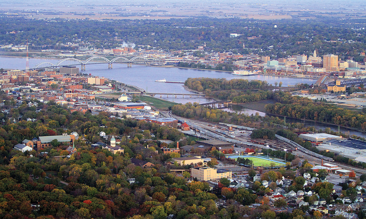 The Centennial Bridge, on the left, and Arsenal Island on the right, are key features of the Mississippi River in the Quad Cities area. Davenport, Iowa, is across the river, and Rock Island, Ill., is in the foreground. (Photo courtesy of Dawson & Associates)