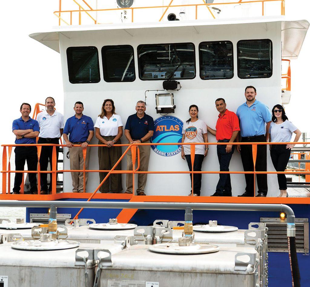 From left: Michael Fahy, Jonathan Brown, Chris Milligan, Donna Garner, Bob Kenyon, Nada and Sam Simon, Clint Werth and Donna Penouilh. (Photo courtesy of Atlas Marine Services)