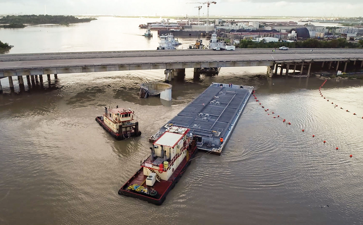 Screen capture from Coast Guard drone video of the removal of the second barge from the I-10 bridge.
