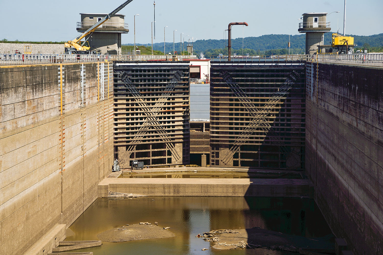 Repairs are underway to the upper miter gates on the main lock at the Robert C. Byrd Locks and Dam. The dam provides a 23-foot lift. (Photo by Jim Ross)
