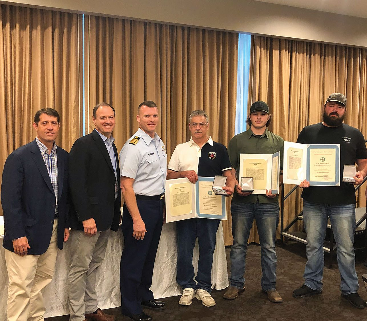 Coast Guard award presentation, from left: David Lane, Canal Barge senior vice president-marketing; Merritt Lane, president and CEO; Coast Guard Capt. Capt. Lewin; Stephan Hill, chief engineer; Dylan Littlejohn, lead deckhand; and Adam 'Gator' Dobbs, pilot. (Photo courtesy of Canal Barge Company)