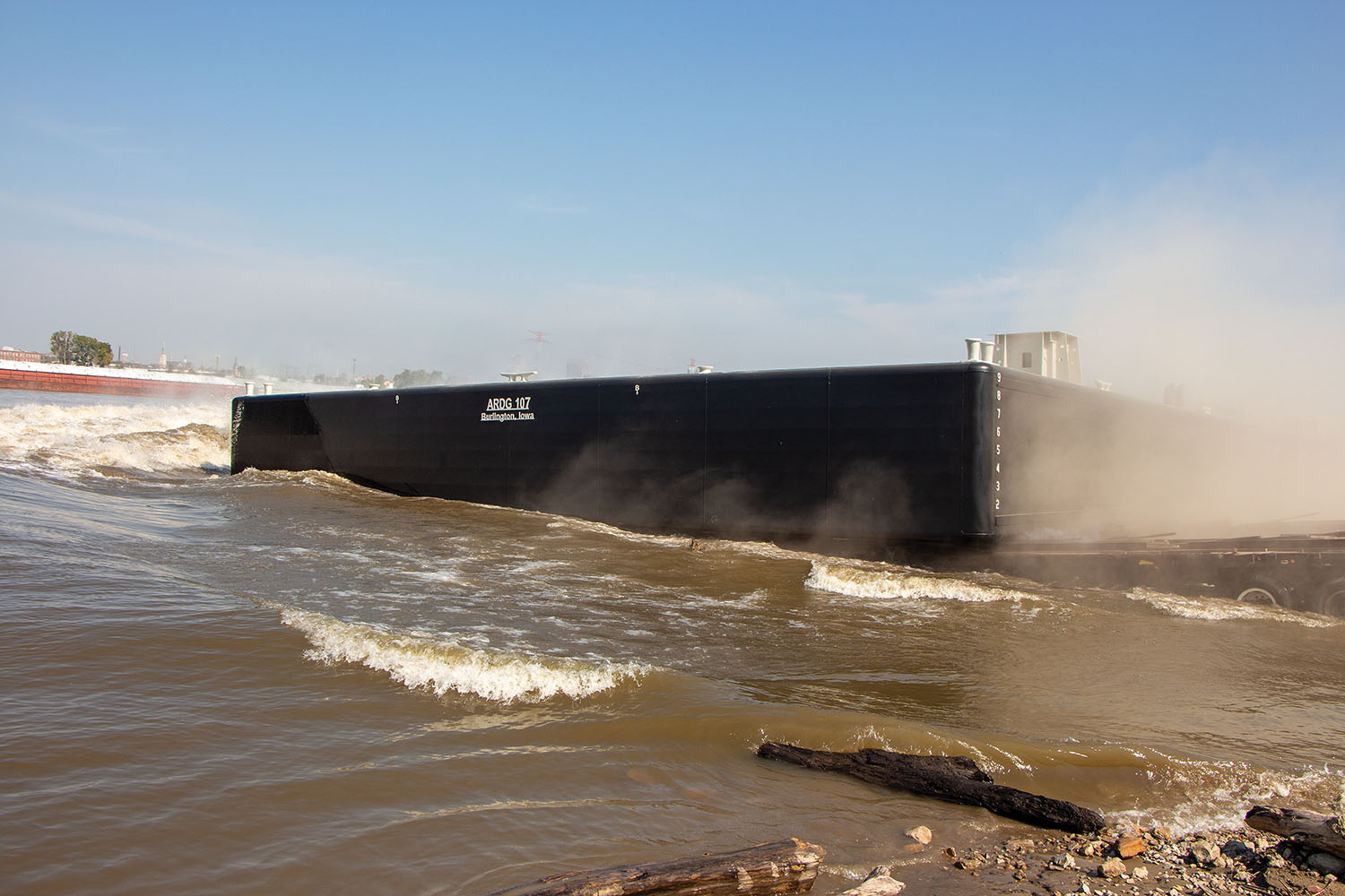 Eagle Fabrication's one-hundredth barge slides into the Mississippi River at Sauget, Ill. (Photo by Jason Koenig)