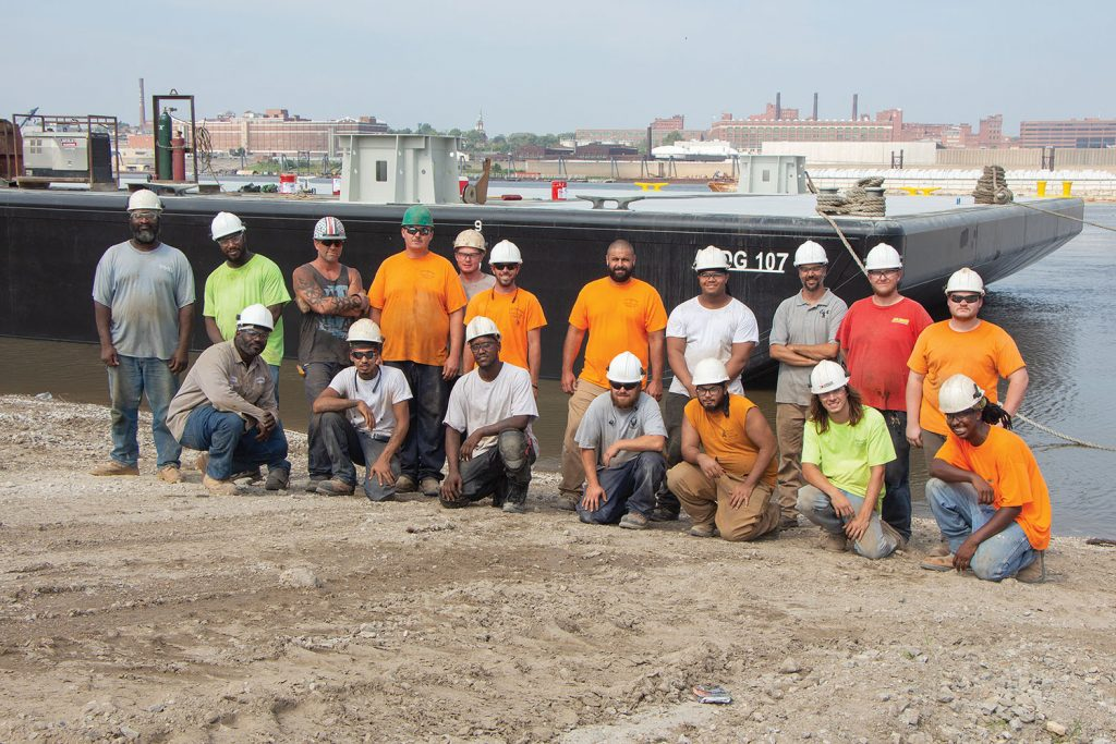 Matt Thomas (without hard hat) amid shipyard workers of Eagle Fabrication. (Photo by Nelson Spencer Jr.)