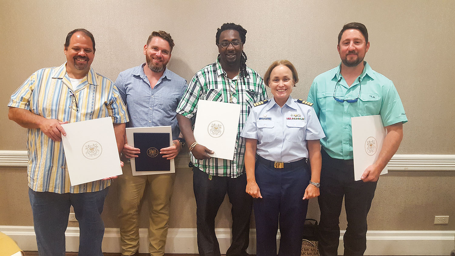 Coast Guard Capt. Kristi Luttrell presented a Certificate of Merit to the crew of the Z-drive ship assist  tug Archie T. Higgins for assisting the Creole Queen when it lost power with 273 passengers on board. From left: mate Eric Burlette, Capt. Josh Sheffield, deckhand Jacob Toliver, Luttrell and engineer Ryan Harrison. (Photo by Capt. Richard Eberhardt)