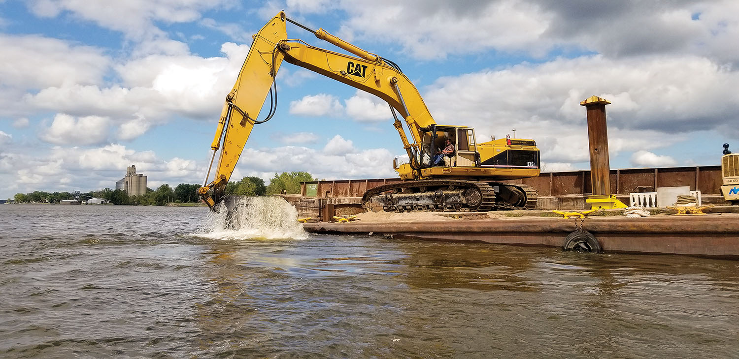 Mechanical dredging on the Upper Mississippi River in the Rock Island Engineer District. (Photo courtesy of Rock Island Engineer District)