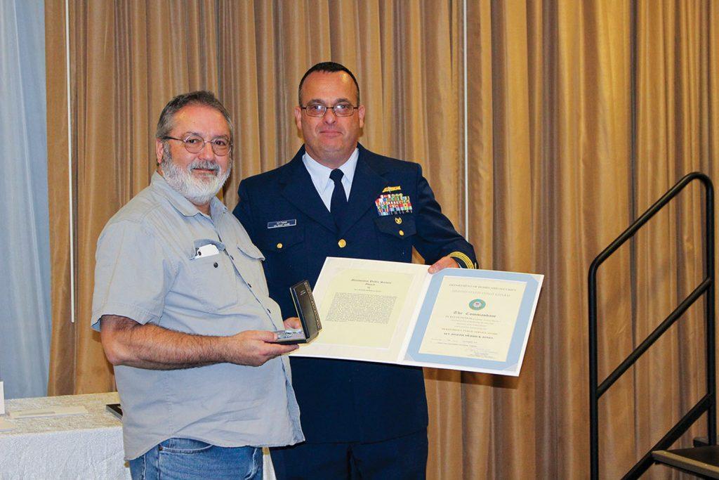 Capt. Dittman presents award to Capt. Roy McManus. (Photo courtesy of Canal Barge Company)