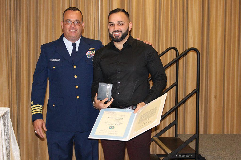 Coast Guard Capt. Dittman presents award to mate Chad Perez. (Photo courtesy of Canal Barge Company)