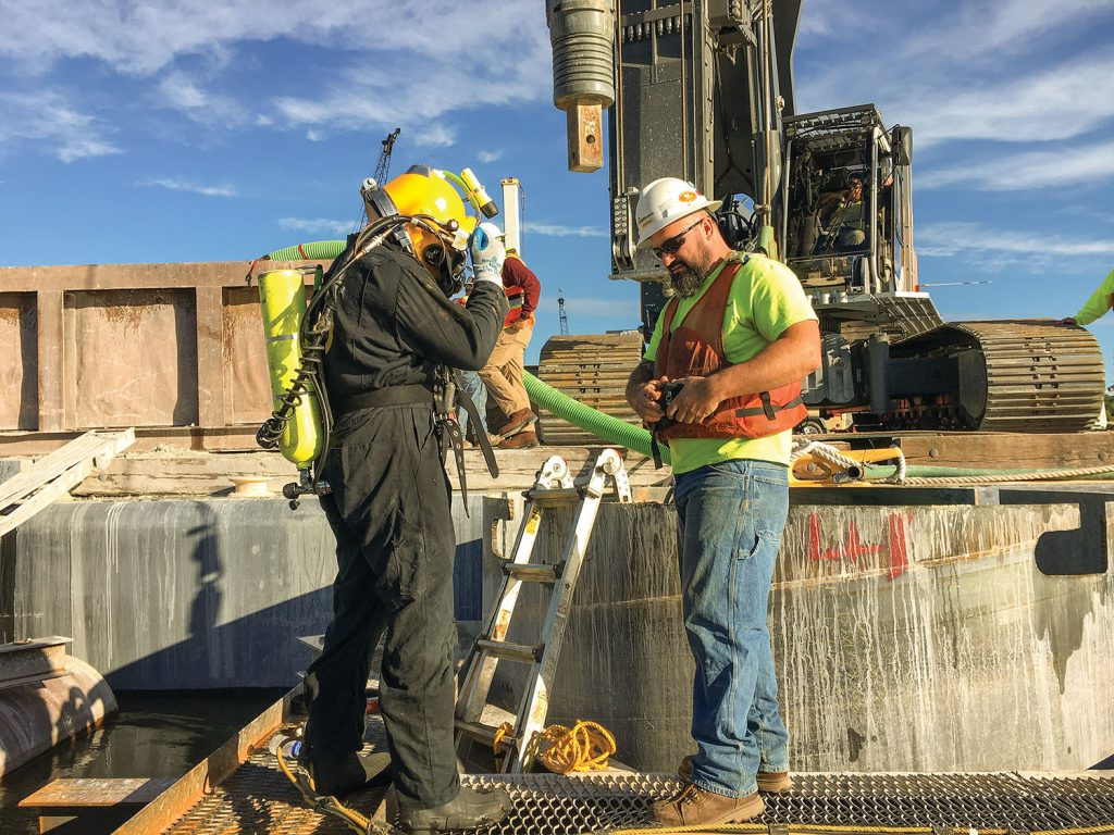 Diver Kyle Kokrda and supervisor Bryan Rich on the I-74 bridge project. (Photo courtesy of J.F. Brennan Inc.)