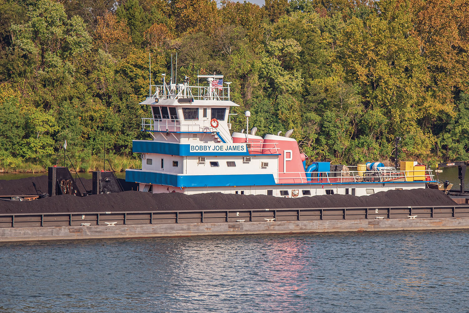 Pictured is the mv. Bobby Joe James coming through Demopolis, Ala. The vessel is named after a retired employee of Parker Towing Company; his wife, Vikki James, is a 20-year breast cancer survivor who volunteers her time working with the Relay for Life program. (Photo by Ford Nixon)