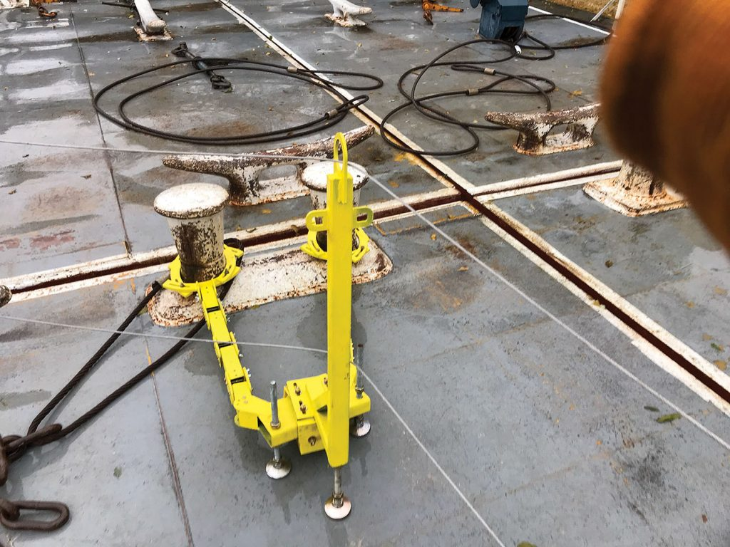 The positioner on the AOI handrail system uses adjustable links that can be set to various lengths, heights and angles. (Photo by Clint Conway/G&C Multi-Services)