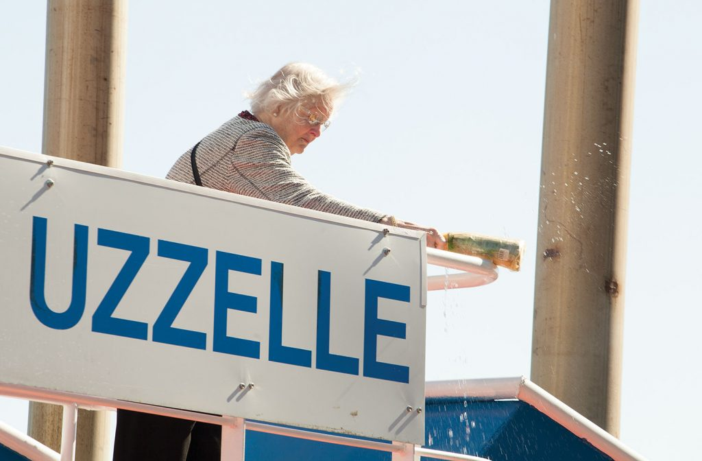 Kathie Uzzelle, wife of the late Hamp Uzzelle, christens the Parker Towing vessel named for her husband. (Photo by Frank McCormack)