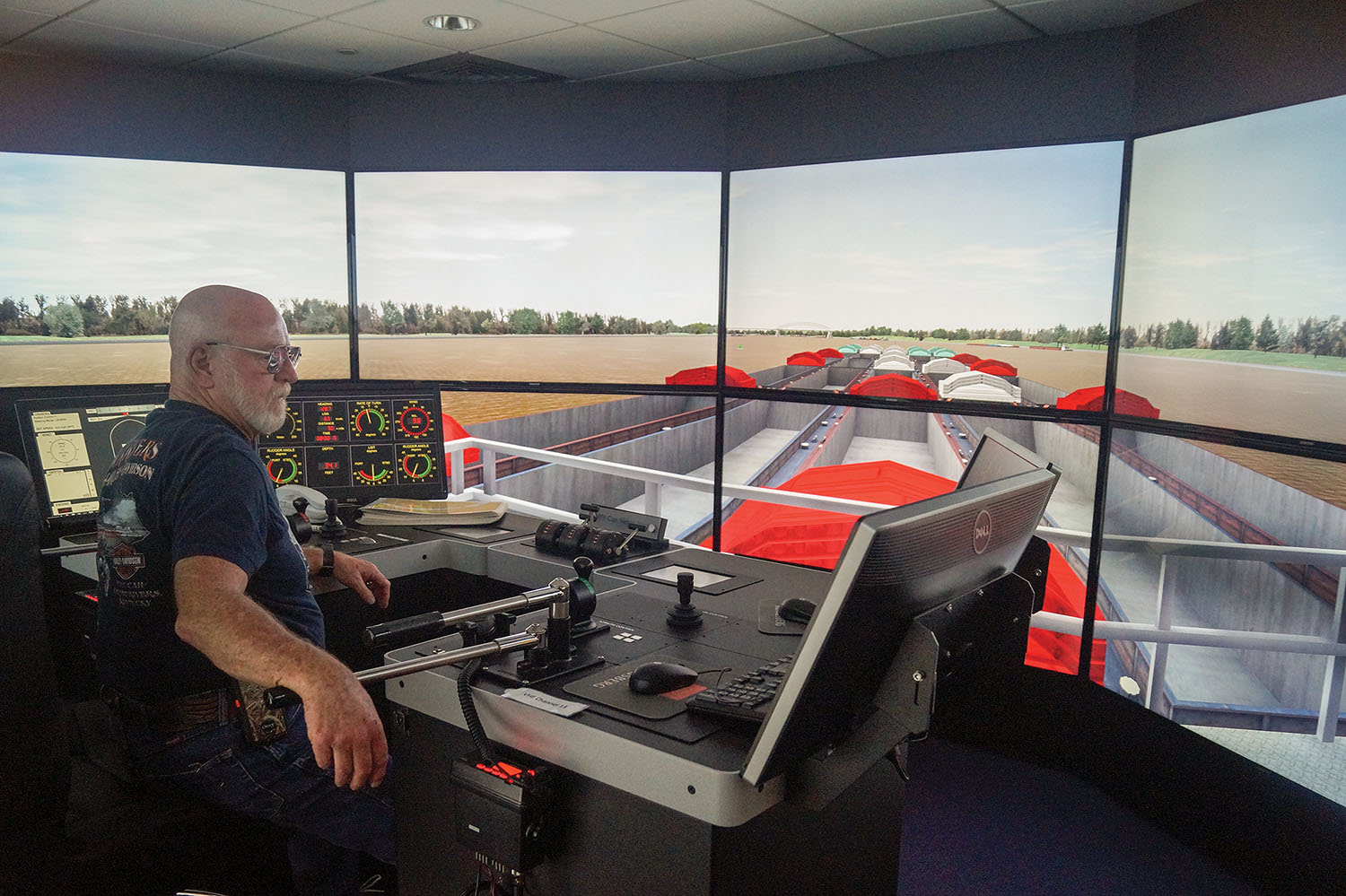 Capt. Don Ryan pilots a simulated towboat near where the Kentucky Transportation Cabinet plans to build a new Interstate 69 bridge connecting Henderson, Ky., with Evansville, Ind. Seamen's Church Institute simulations have helped bridge designers choose appropriate bridge alignments and pier placements to improve safety on the waterways. (Photo by Keith Todd/Kentucky Transportation Cabinet(