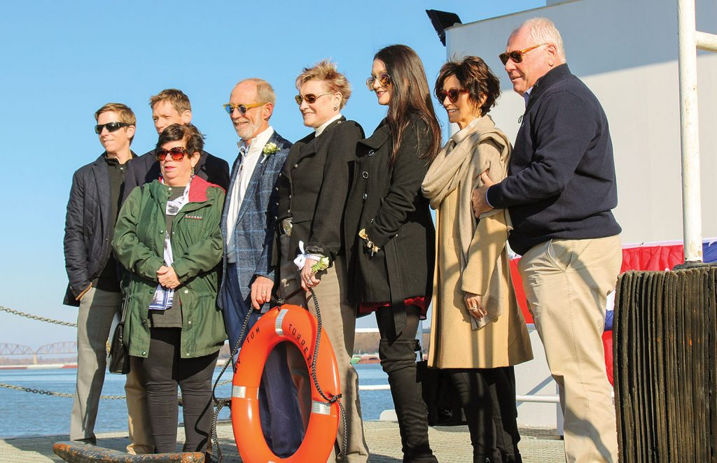 Tom Torretti (fourth from left in blue jacket) and his family pause for a quick photo on board his namesake vessel. (Photo by Shelley Byrne)