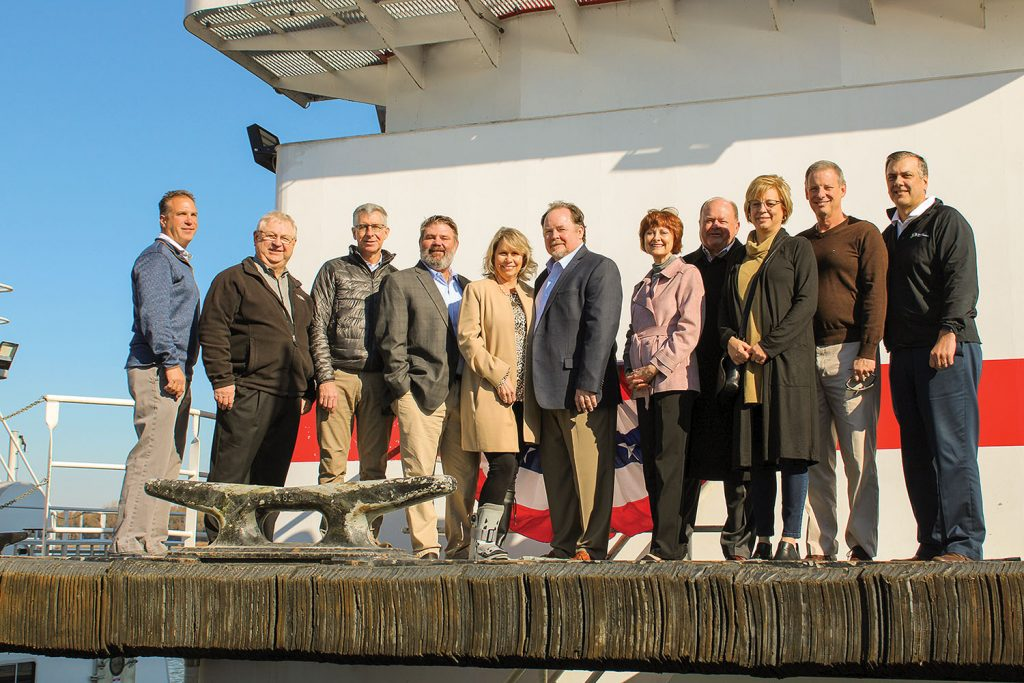 Rick Pemberton (sixth from left) and his family line up for a photo aboard his namesake vessel. (Photo by Shelley Byrne)