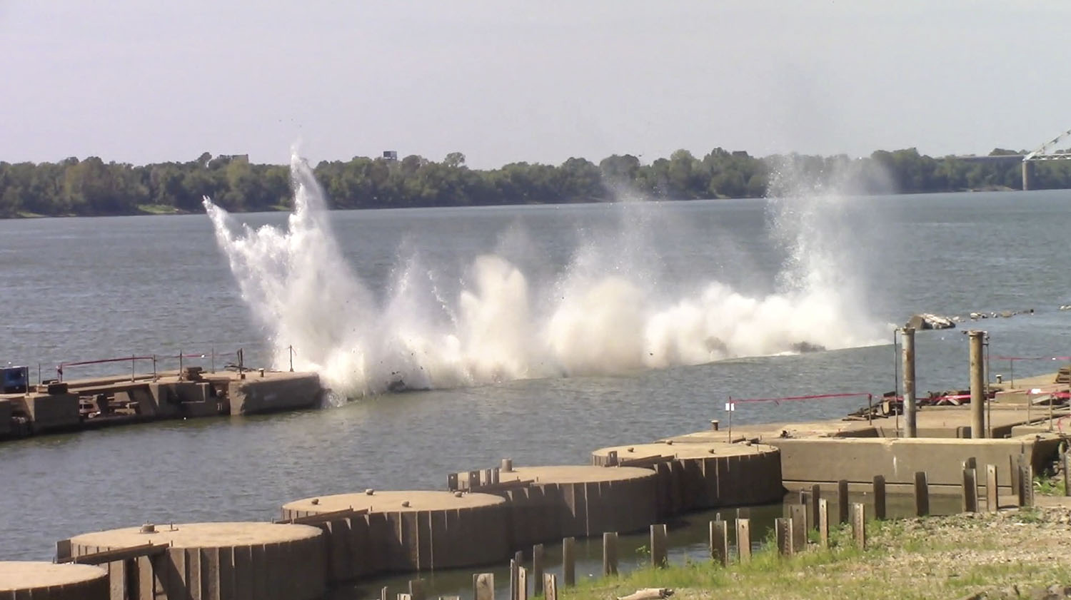 An explosive blast earlier this year is used to remove the downstream lock approach wall at Locks and Dam 52 on the Ohio River near Brookport, Illinois. (Photo courtesy of Louisville Engineer District)