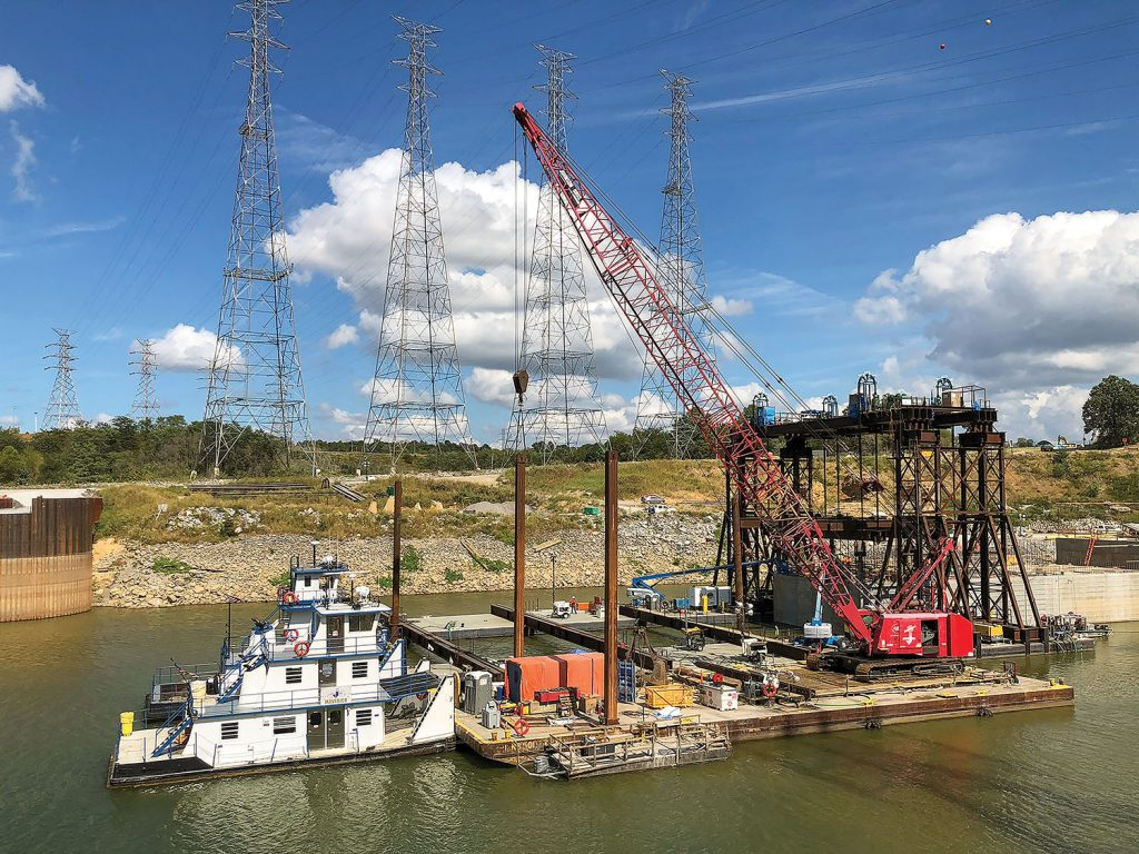 The Nashville Engineer District and its contractor partner Johnson Brothers near completion in setting a 1.3-million-pound concrete shell September 23, 2019, on the riverbed on the downstream end of Kentucky Lock, where it will be part of a cofferdam and eventually a permanent part of the new lock wall. It was the eighth of 10 shells that are being placed. (Photo by Barney Schulte)