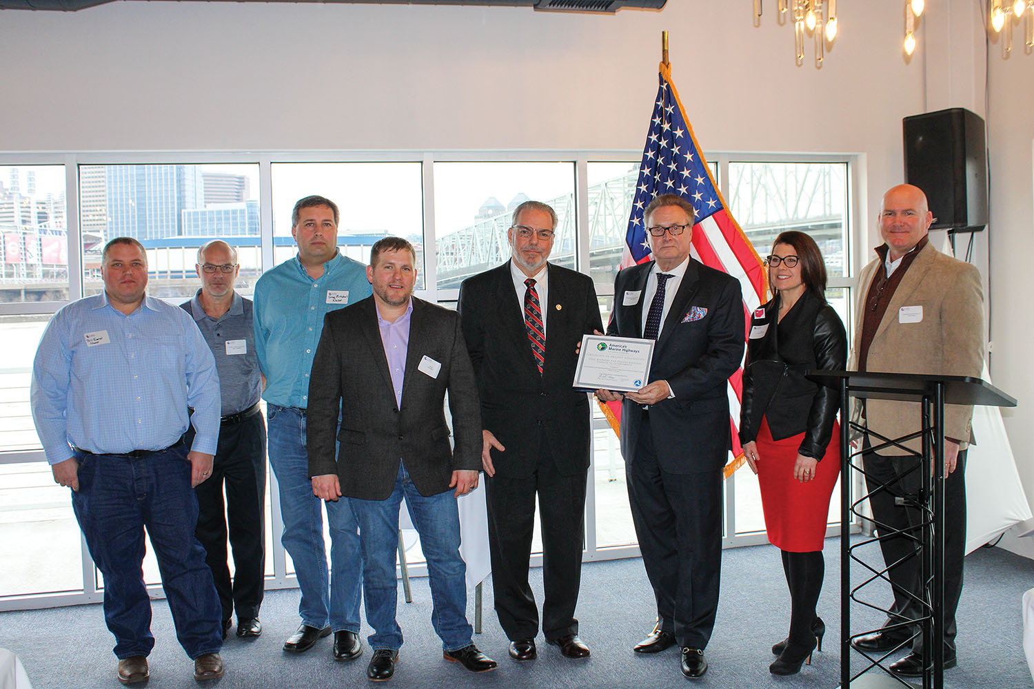 Tim Pickering (third from right) of the U.S. Maritime Administration presents a certificate designating a Nucor Steel's hauling of steel coils by barge from Gallatin, Ky., to customers via the Port of Louisville as a marine highway project. The Ohio, Kentucky and Indiana Regional Council of Governments was the project sponor. Partners included Nucor Steel, the Central Ohio River Business Association and several ports in Kentucky, Indiana and Ohio. (Photo by Shelley Byrne)