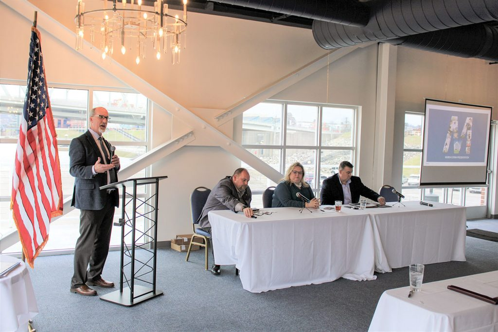 Eric Thomas, president of the Central Ohio River Business Association (CORBA) introduces panelists to discuss the future of container-on-barge services. From left are Mike Leopold of Mubea North America, Nicole Favorite of Horizon Freight System Inc. and Rich Teubner of SEACOR AMH LLC. (Photo by Shelley Byrne)