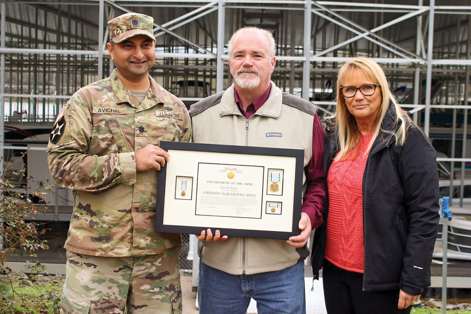 Lt. Col. Sonny B. Avichal, Nashville Engineer District commander, left, with Kevin and Donna Jones. The Corps presented Kevin Jones with the Army Commander's Award for Public Service after he rescued a man whose vehicle entered a water at a marina boat ramp. Kevin Jones is one of the co-owners of Wildwood Resort and Marina on Cordell Hull Lake in Granville, Tenn. (Photo by Ashley Webster, U.S. Army Corps of Engineers)