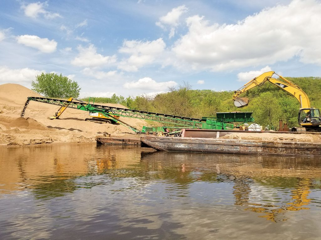 Dredged material unloading operation at a placement site in Pool 6. (Photo courtesy of St. Paul Engineer District)