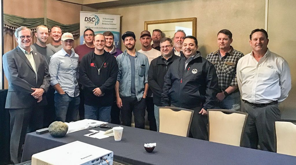"""Participants of DSC Dredge's 2020 """"Dreducation Class"""" gather for a photo. Pictured from DSC Dredge are Charles Johnson (left), director of sales for DSC Dredge, and William Wetta (right), DSC's senior vice president and chief technology officer."""
