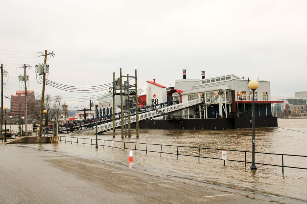 heavy rain swelled the Ohio River in Newport, Ky., on February 13, causing extended walkways to be used at BB Riverboats' Newport landing. (Photo by Shelley Byrne)