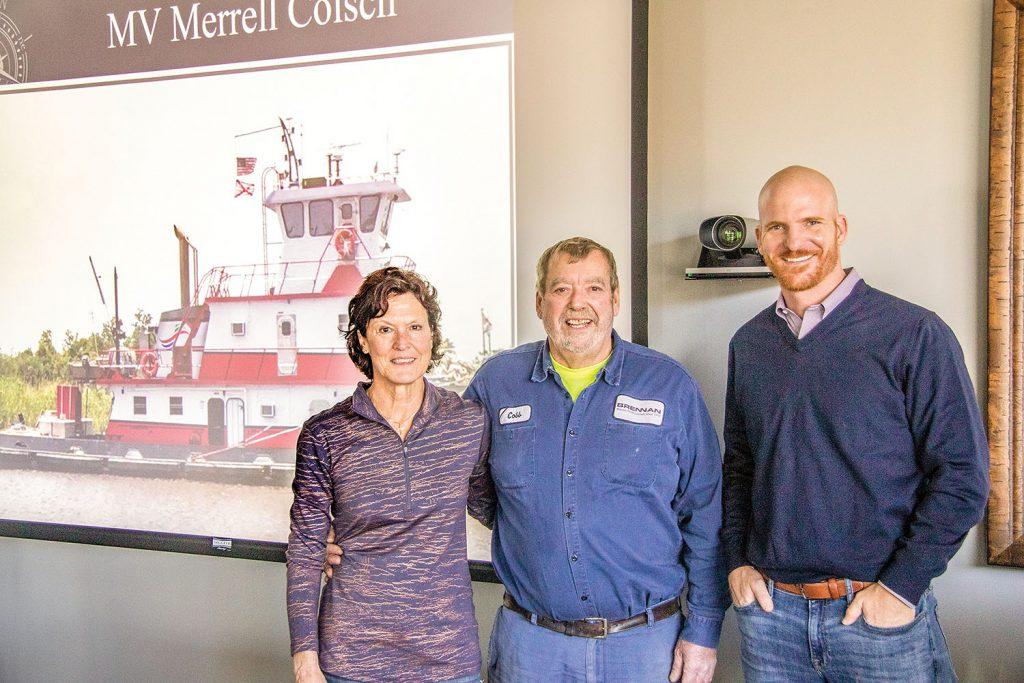 The vessel's namesake, Merrell Colsch (center), with his wife Karen and Adam Binsfeld, president of J.F Brennan Company Inc.