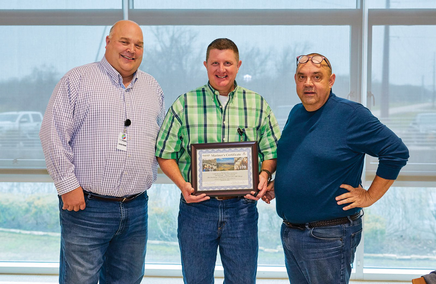 From left, Eric Gilmore from the Red River Waterway Commission, Nucor Corporation's Jeff Jeffcoat and Ted Knight, director of Operations for Port of Caddo-Bossier, gather for a photo at the luncheon celebrating the 100th barge loaded with steel coils from Nucor handled at the port. (Photo courtesy of Port of Caddo-Bossier)