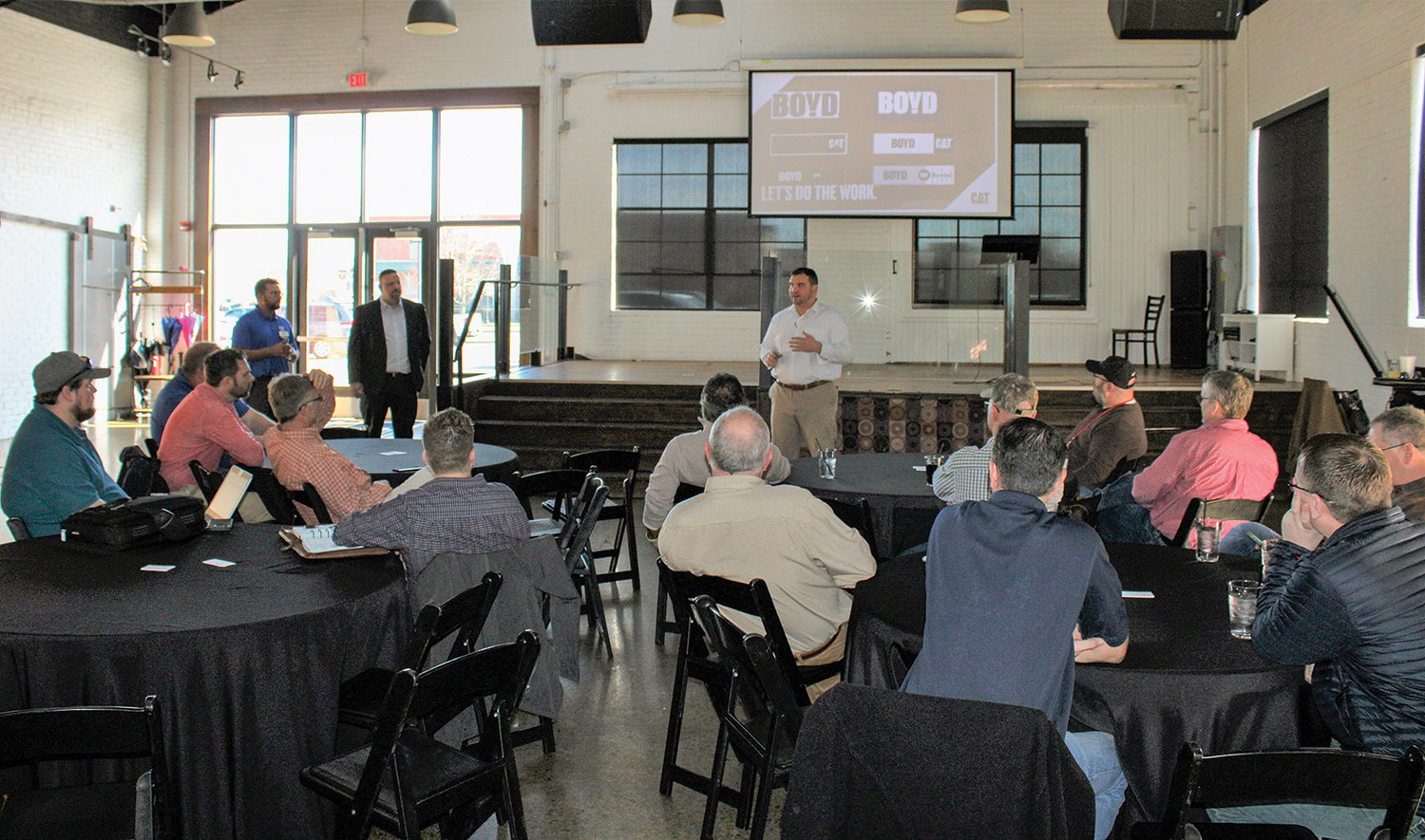 Lincoln Turnage of Boyd Cat talks to marine industry customers about Whayne Supply changing its name to Boyd Cat but retaining the same ownership. Boyd Cat hosted a digital workshop at the 1857 Hotel in Paducah to introduce customers to Caterpillar's available digital services. (Photo by Shelley Byrne)