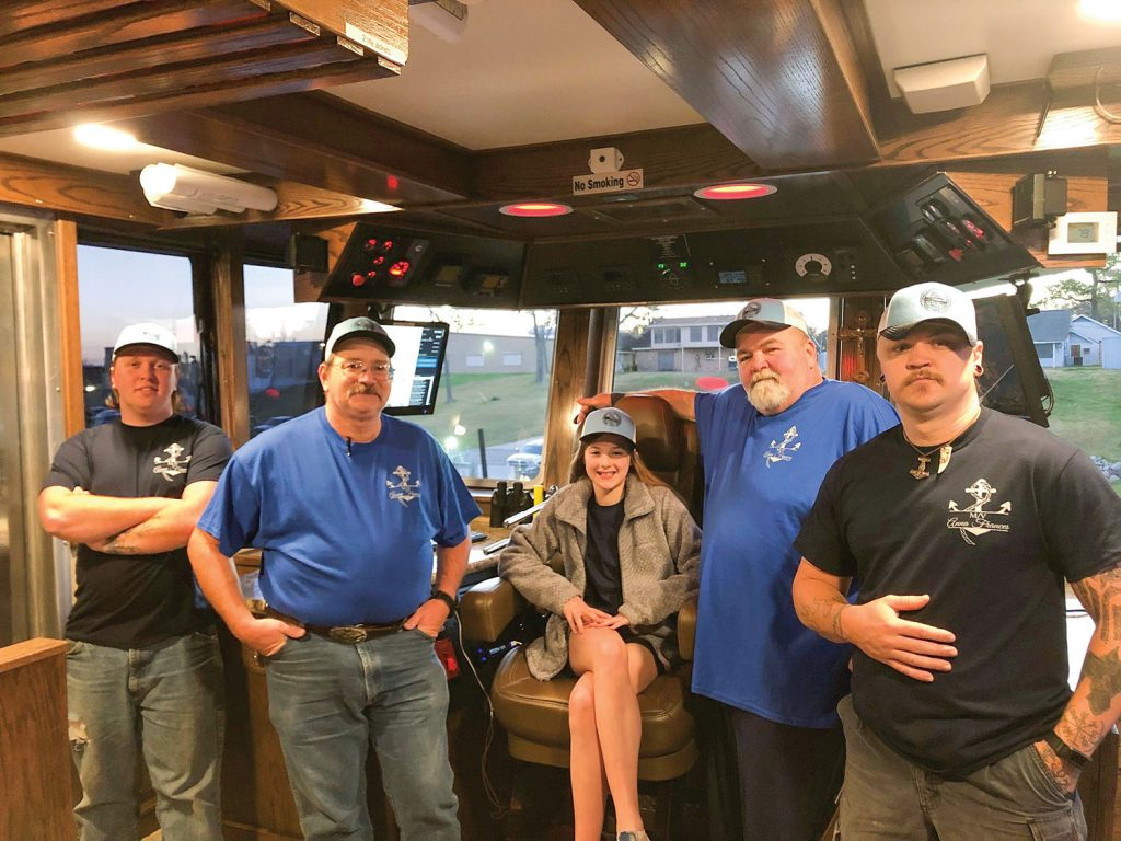 Anna Frances Devall with the crew of her namesake vessel in the pilothouse.