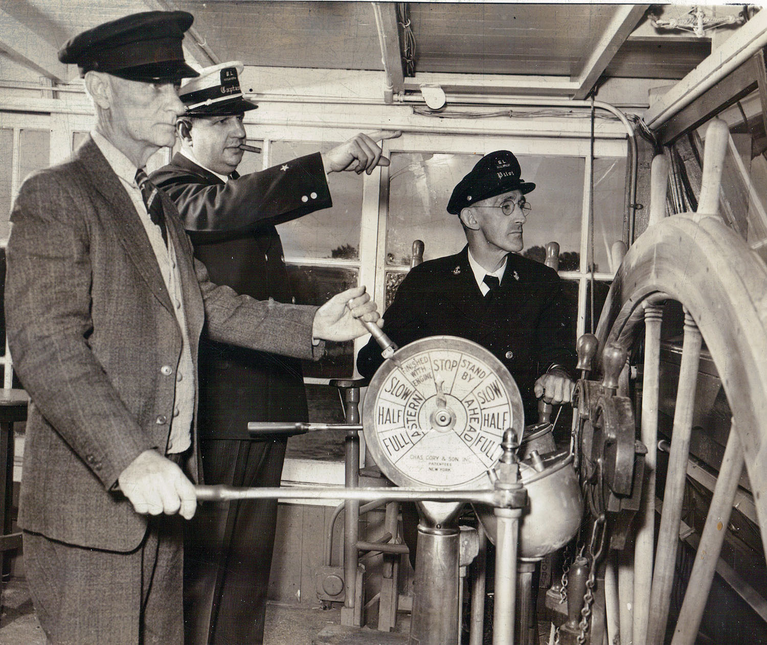 The pilothouse interior of the Str. Gordon C. Greene shows Capt. Billy Noland at the Gardner steering levers, as Capt. Tom Greene and Capt. Jesse Hughes look on in June of 1944. (Keith Norrington collection)