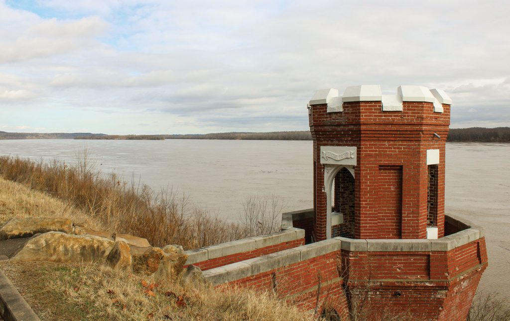 """The brick and masonry pump house is the only one of its kind remaining on the Ohio River. It is an exact replica of the U.S. Corps of Engineers logo and features an engraving of the Corps motto """"Essayons,"""" meaning """"Let Us Try,"""" in Latin."""