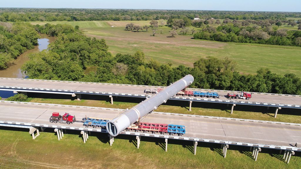 Following the barge move, the column vessel had to span both directions of the highway crossing the San Bernard River because of bridge weight restrictions. (Photo courtesy of Barnhart Crane & Rigging)