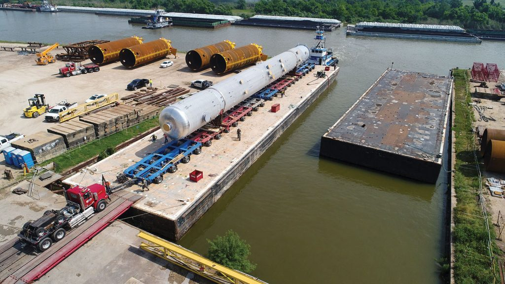 317-foot-long, 800,000-pound depropanizer column vessel moved by barge from Houston to Freeport, Texas. (Photo courtesy of Barnhart Crane & Rigging)