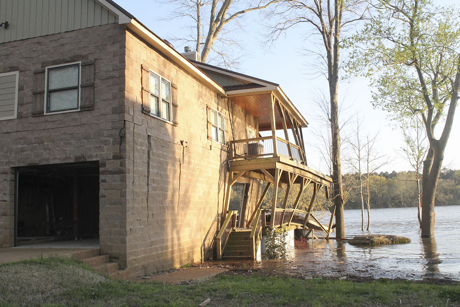 The U.S. Coast Guard said a house on Arnold Drive in Savannah, Tenn., received significant damage after 14 empty barges broke away from the mv. Roger L. Knight, which had been chartered by Inland Marine Service. (Photo by R. Kelly Jordan, The Courier)