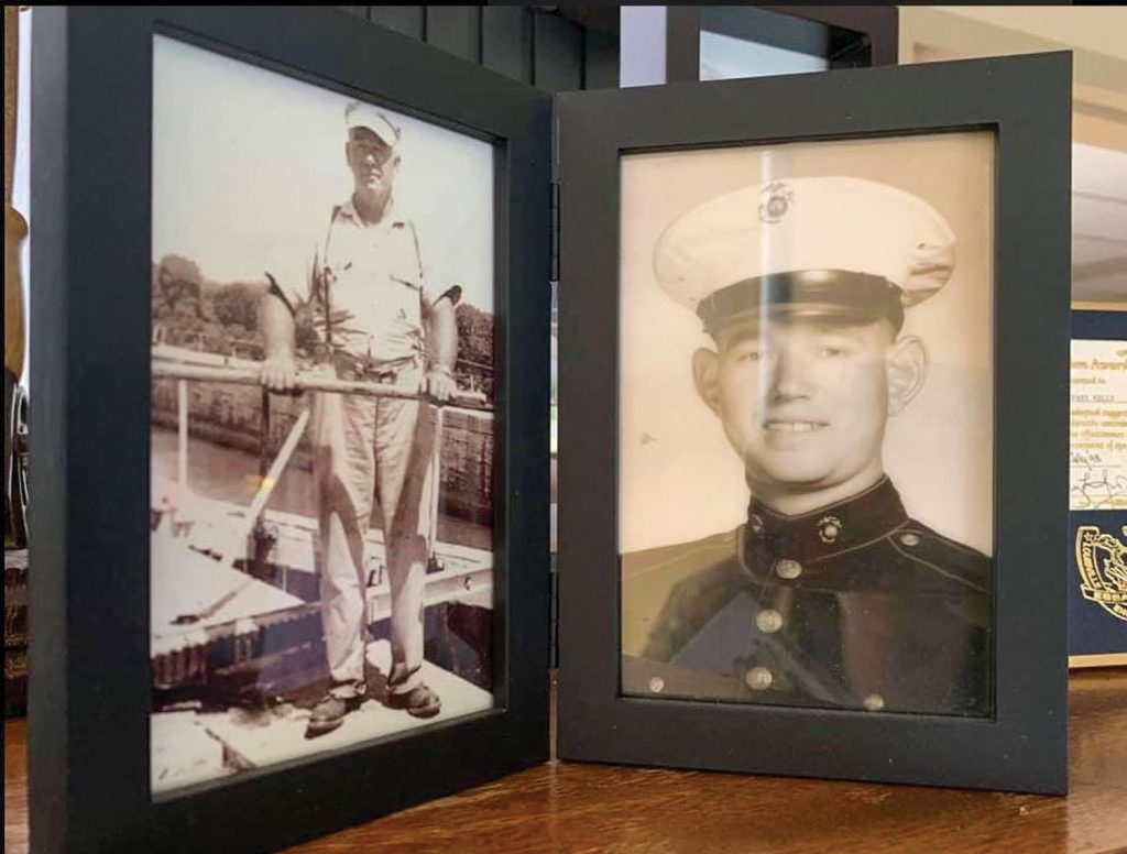 Portraits of Jeff Kelly's grandfather, Paris Kelly (left) and father, Wayne Kelly (right) are displayed in Jeff Kelly's office at Smithland Locks and Dam. Four generations of the Kelly family have worked for the Corps at locks and dams. (Photo courtesy of Louisville Engineer District)