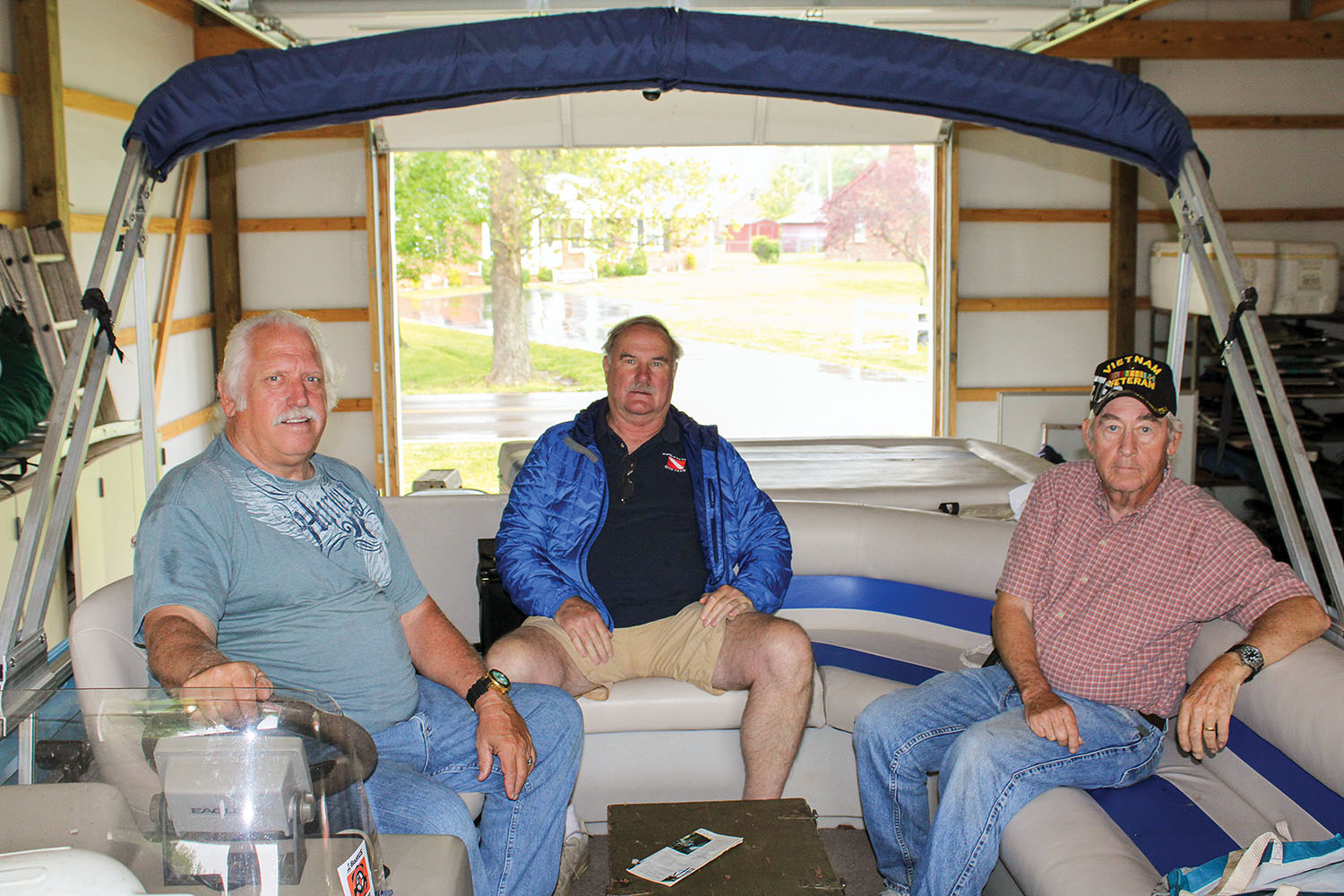 Friends Capt. Bob Cherry Jr., Sherman Jones and Sterling Edwards (left to right) prepare to take Cherry's pontoon boat, My Cheri, down the entire 652-mile navigable length of the Tennessee River. (Photo by Shelley Byrne)