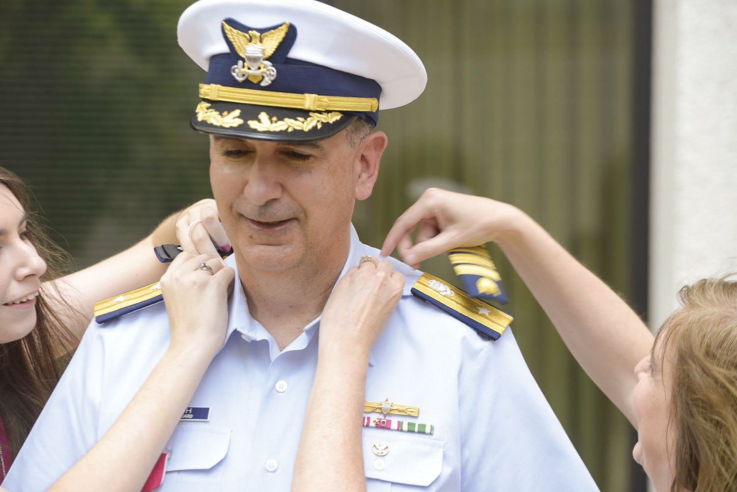 Rear Adm. Shannon Gilreath receives new shoulder boards from his daughter and wife during the May 22 frocking ceremony. (U.S. Coast Guard photo)