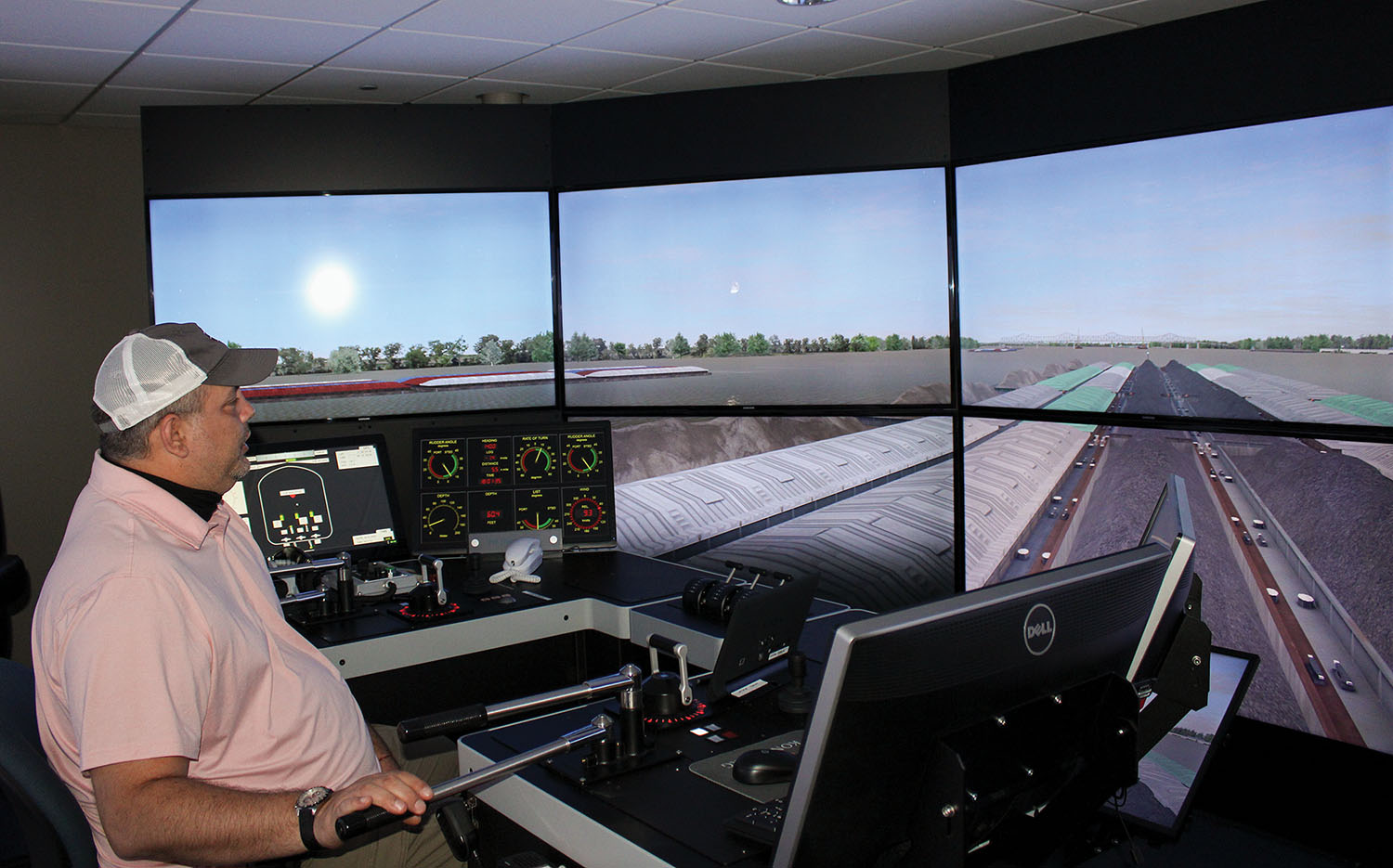 Ingram Barge Company Capt. Joseph Eubanks, piloting a Seamen's Church Institute towboat simulator, is downbound toward the piers of a new U.S. 51 bridge over the Ohio River, connecting Cairo, Ill., and Wickliffe, Ky. (Photo by Shelley Byrne)