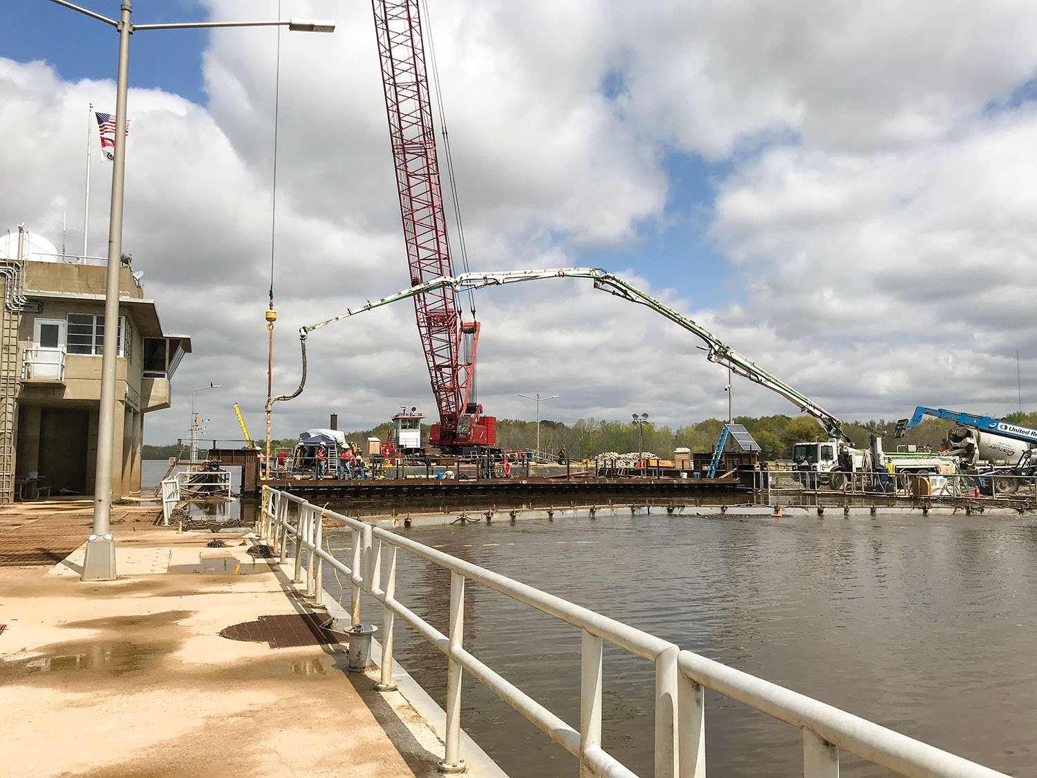 Larger-than-expected voids meant Massman had to bring in an additional floating crane and use tremie concrete and pressure grouting. (Photo courtesy of Massman Construction)