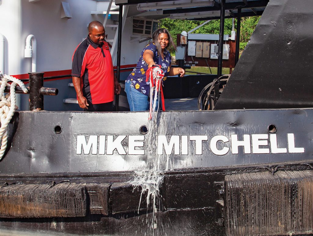 Natasha Mitchell, wife of Captain Mike Mitchell, officially christens the mv. Mike Mitchell into the Wood Towing fleet May 12. (Photo by Frank McCormack)