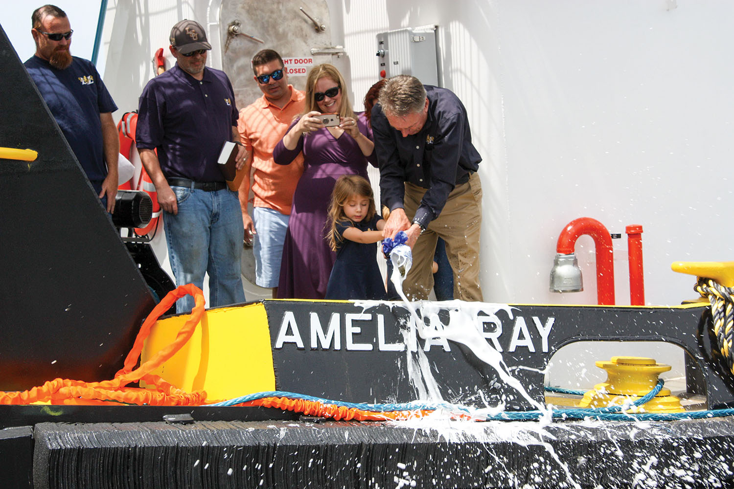 With a little help from her grandfather, Amelia Ray Balser breaks bottle to christen her namesake vessel. (Photo courtesy of L&L Marine)